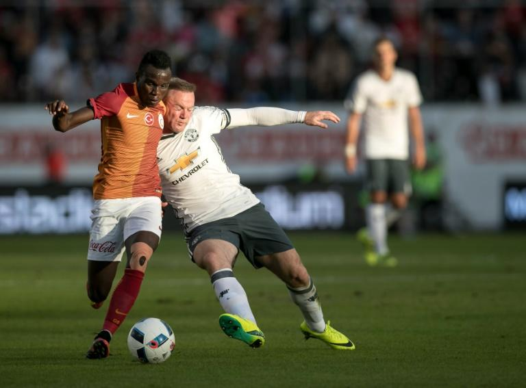 United's Wayne Rooney vies with Galatasaray's Hakan Balta during the Galatasaray v Manchester United pre-season friendly football match on Ullevi Stadium, Goteborg on July 30, 2016