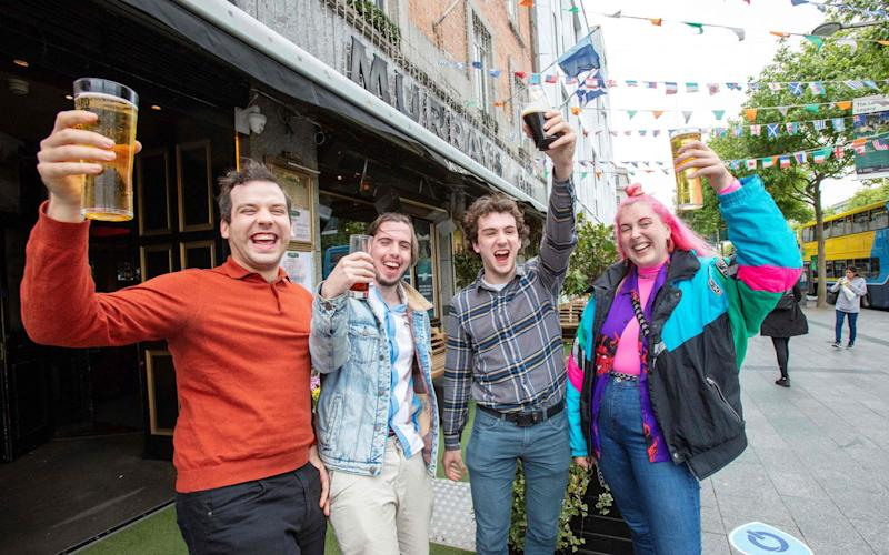 Drinkers in Dublin celebrate last month after pubs that sell food open again - but now drinking-only outlets are to stay closed after a setback in the fight against Covid-19 - Paul Faith/AFP