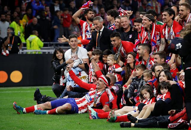 Soccer Football - Europa League Final - Olympique de Marseille vs Atletico Madrid - Groupama Stadium, Lyon, France - May 16, 2018 Atletico Madrid's Antoine Griezmann, team mates and their families celebrate after winning the Europa League REUTERS/Christian Hartmann