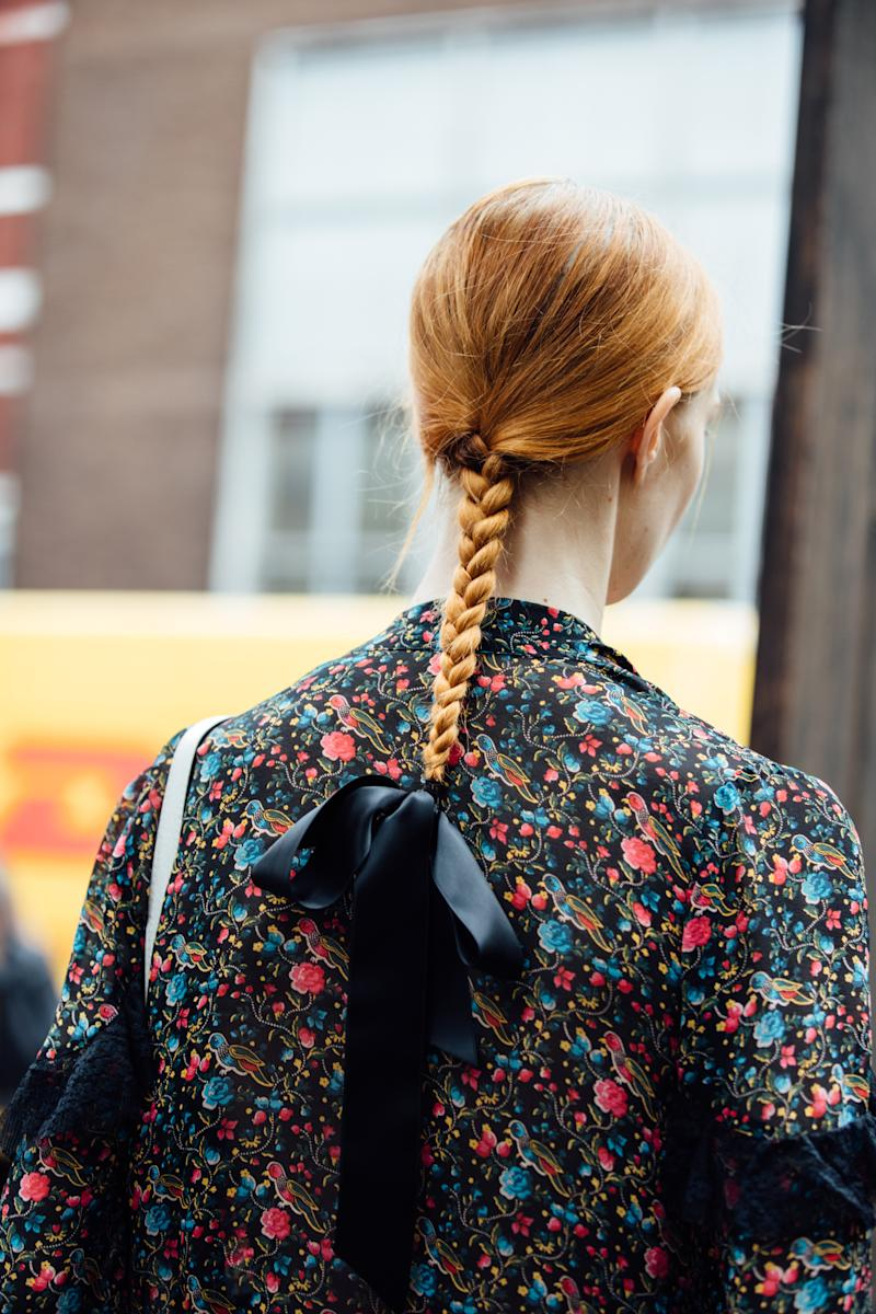 LONDON, ENGLAND - SEPTEMBER 16: A model with a braided ponytail and bow in the hair after the Erdem show during London Fashion Week September 2019 on September 16, 2019 in London, England. (Photo by Melodie Jeng/Getty Images)