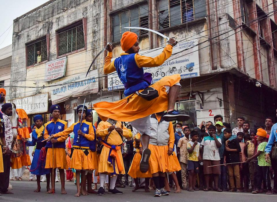 Sikh devotees perform martial arts 'Gatka' as they participate in 'Nagar Kirtan' (holy procession), ahead of the birth anniversary of Guru Gobind Singh ji, near Central Gurudwara Sahib Gowliguda, in Hyderabad, on Monday, 18 January 2021.