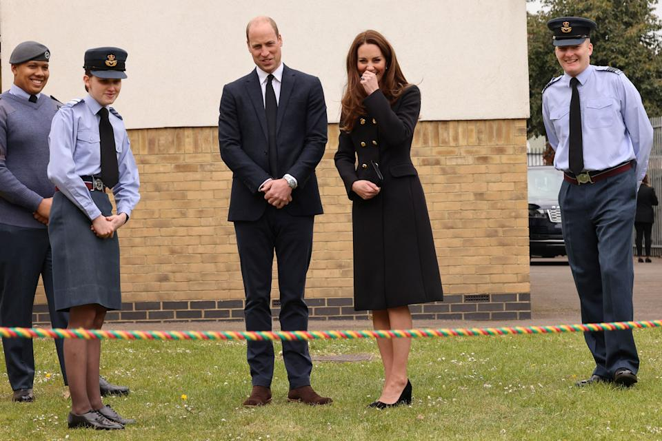 Britain's Prince William, Duke of Cambridge, and Britain's Catherine, Duchess of Cambridge, wearing black as a mark of respect following the death of Britain's Prince Philip, Duke of Edinburgh, meet air Cadets during their visit to 282 (East Ham) Squadron Air Training Corps in east London on April 21, 2021. - During the visit, the Squadron paid tribute to The Duke of Edinburgh, who served as Air Commodore-in-Chief of the Air Training Corps for 63 years. In 2015, The Duke passed the military patronage to The Duchess of Cambridge who became Honorary Air Commandant. (Photo by Ian Vogler / POOL / AFP) (Photo by IAN VOGLER/POOL/AFP via Getty Images)