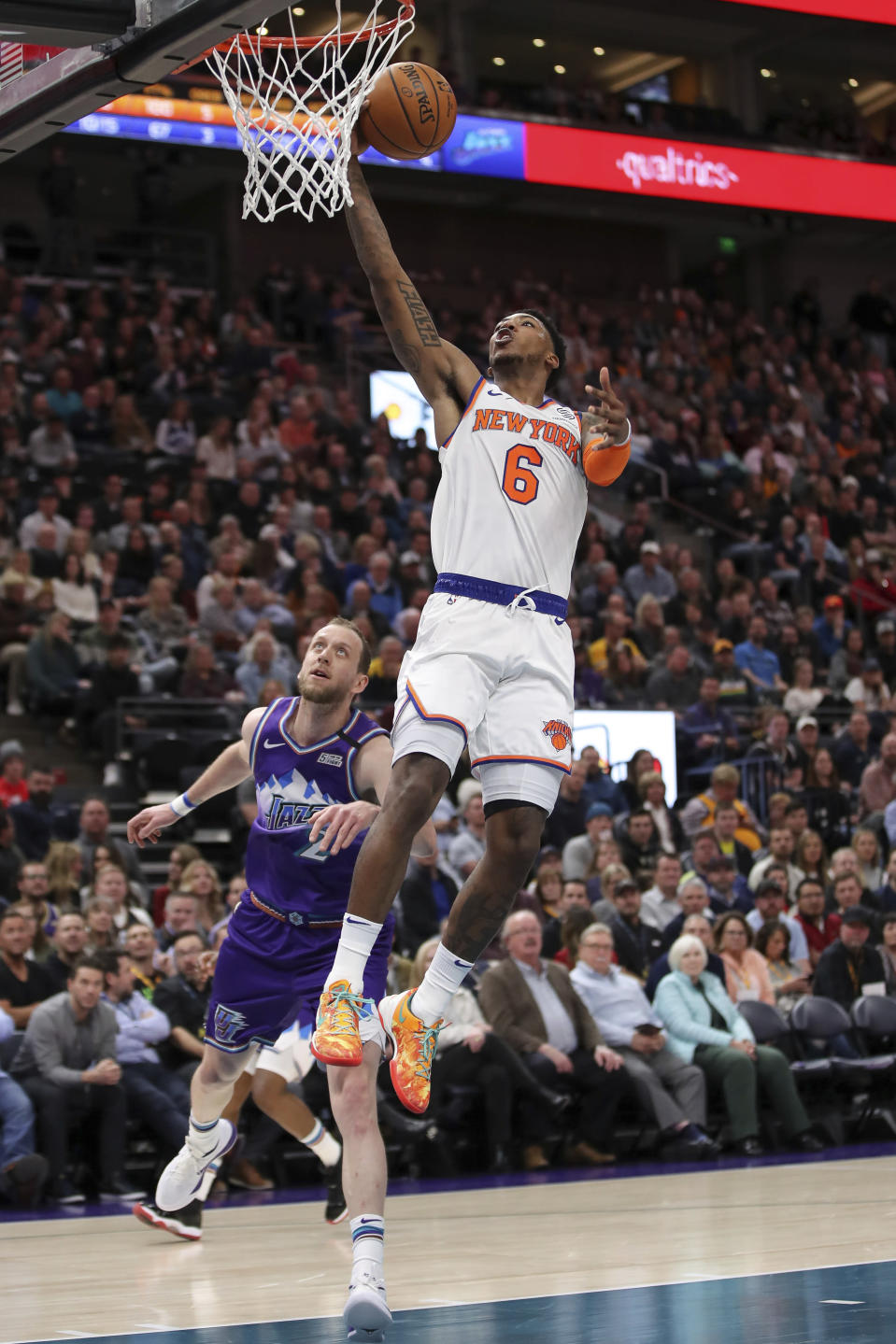 New York Knicks guard Elfrid Payton (6) lays the ball up next to Utah Jazz forward Joe Ingles (2) during the second quarter of an NBA basketball game Wednesday, Jan. 8, 2020, in Salt Lake City. (AP Photo/Chris Nicoll)