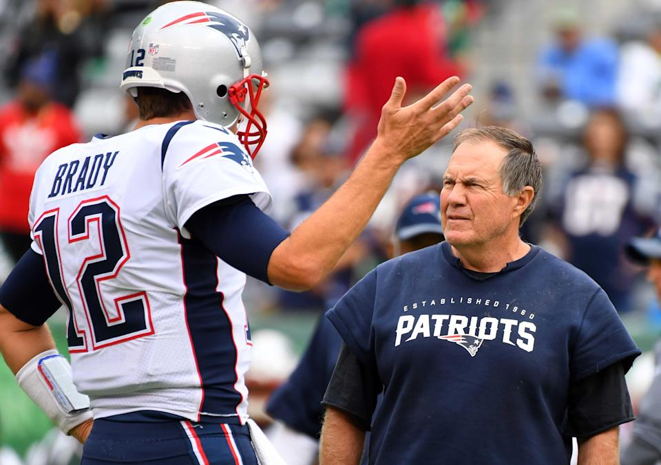 New England Patriots head coach Bill Belichick and  quarterback Tom Brady (12) before the game against The New York Jets at MetLife Stadium.