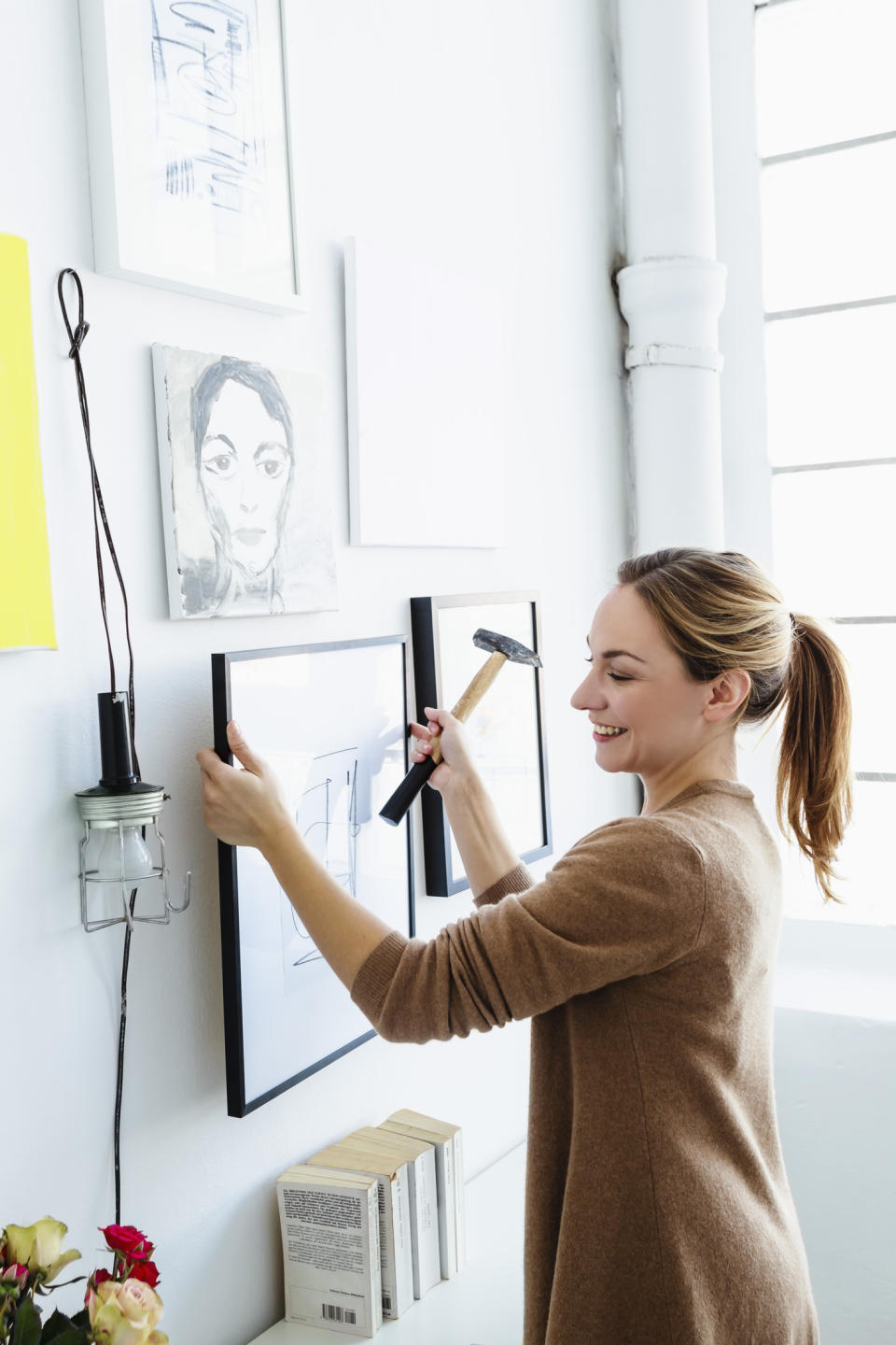 Using toothpaste to help hang a picture is one of the suggested DIY hacks. (Getty Images)