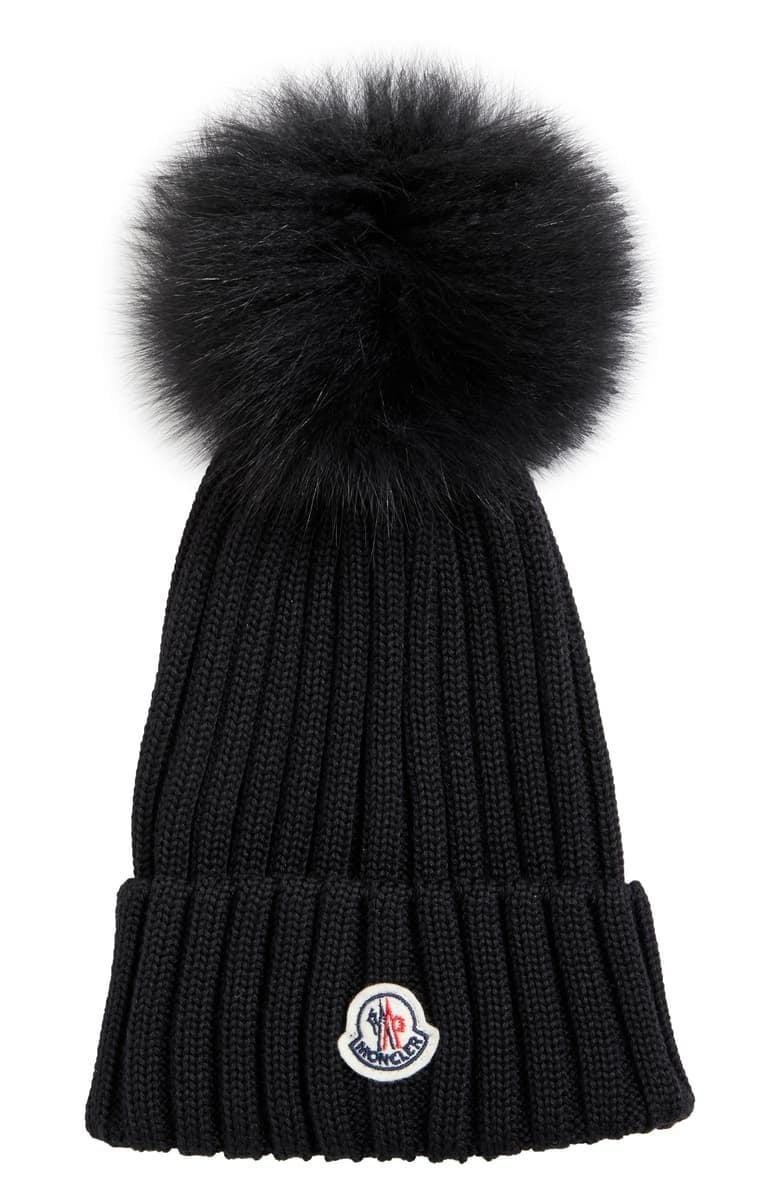 <p>If you're looking for something luxe, splurge on this <span>Moncler Rib Wool Hat with Genuine Fox Fur Pom</span> ($355).</p>
