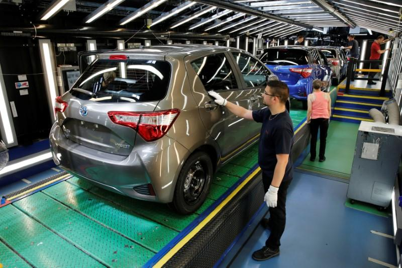 A Toyota Motor Corp. worker inspects a Yaris on the production line of the company's plant in Onnaing, near Valenciennes, France, May 17, 2017. REUTERS/Benoit Tessier/File Photo
