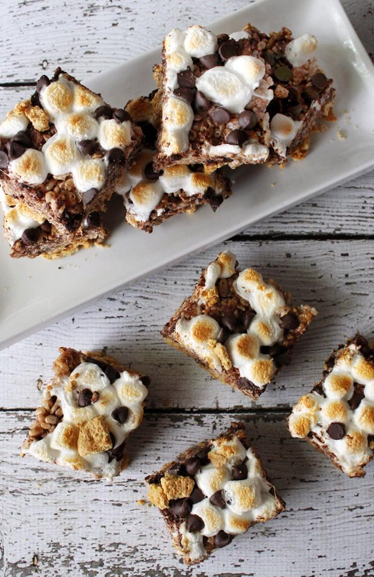 "<p>Two childhood favorites combine forces in this recipe for <a href=""http://portandfin.com/smores-rice-krispie-treats/"" class=""link rapid-noclick-resp"" rel=""nofollow noopener"" target=""_blank"" data-ylk=""slk:s'mores Rice Krispies treats"">s'mores Rice Krispies treats</a>.</p>"