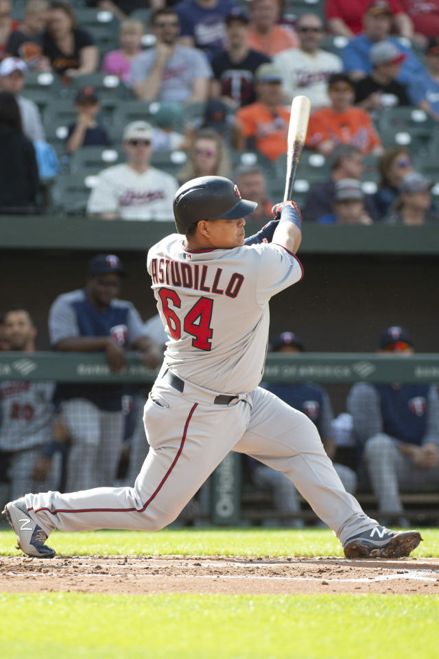 Minnesota Twins' Willians Astudillo (64) hits a home run in the second inning of a baseball game against the Baltimore Orioles, Saturday, April 20, 2019, in Baltimore. (AP Photo/Tommy Gilligan)