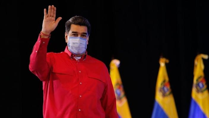 Handout photo made available by the Miraflores press shows president of Venezuela, Nicolas Maduro, during a ceremony with the governors and pro-government mayors, in Caracas, Venezuela, 29 December 2020.