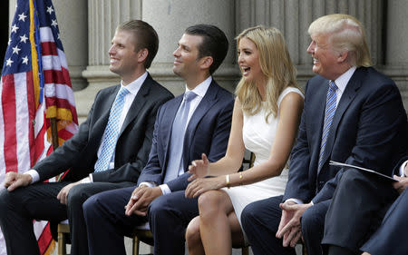 FILE PHOTO: (L-R) Eric Trump, Donald Trump Jr., and Ivanka Trump and Donald Trump attend the ground breaking of the Trump International Hotel at the Old Post Office Building in Washington July 23, 2014. REUTERS/Gary Cameron