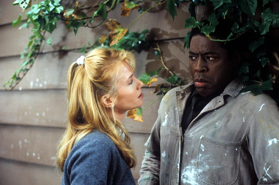Rebecca De Mornay approaches Ernie Hudson in a scene from the film 'The Hand That Rocks the Cradle', 1992. (Photo by Buena Vista/Getty Images)