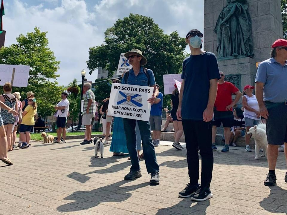 People are seen protesting Nova Scotia's vaccine passport system in August 2021. Premier Tim Houston says people have a right to protest, but that right shouldn't get in the way of health-care workers' ability to go to work or patients to receive services. (Aly Thomson/CBC - image credit)
