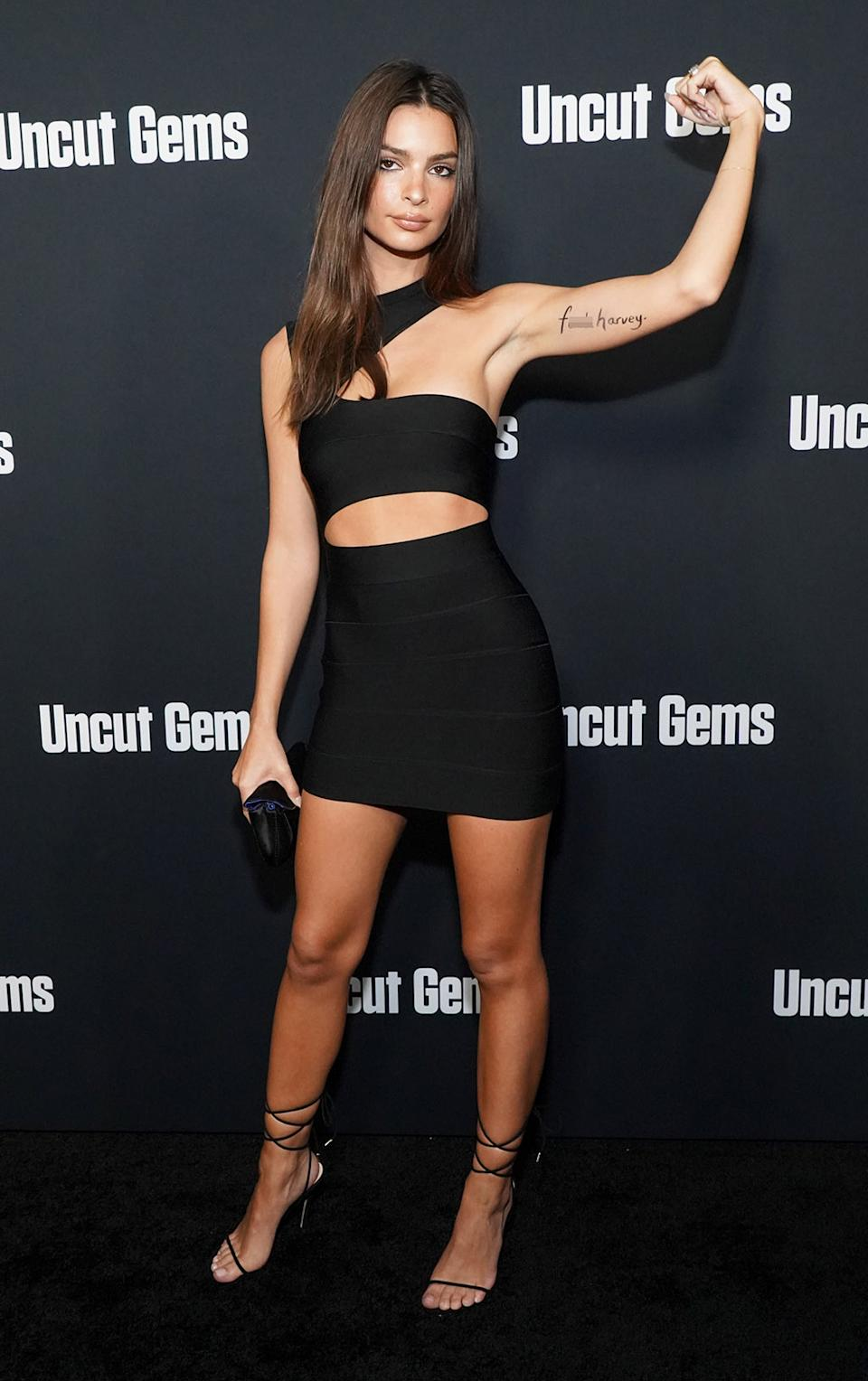 "HOLLYWOOD, CALIFORNIA - DECEMBER 11: (EDITORS NOTE: Image contains profanity.) Emily Ratajkowski attends the premiere of A24's ""Uncut Gems"" at The Dome at Arclight Hollywood on December 11, 2019 in Hollywood, California. (Photo by Rachel Luna/WireImage)"