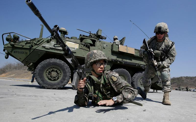 U.S. Army soldiers from the 25th Infantry Division's 2nd Stryker Brigade Combat Team and a South Korean Army soldier participate in a demonstration of the combined arms live-fire exercise during the annual joint military exercise Foal Eagle - AP