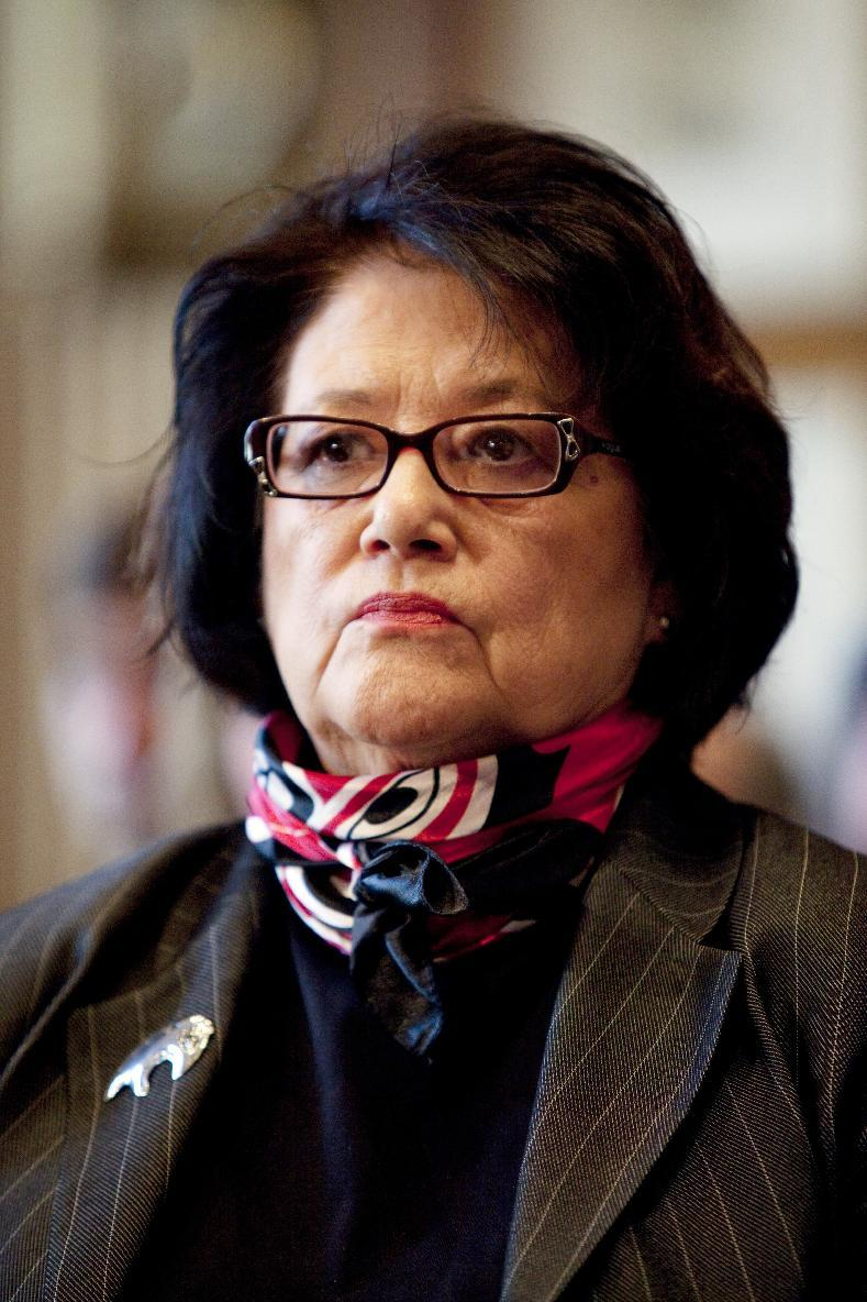FILE - In a Dec. 17, 2009, file photo, Elouise Cobell watches a Senate Indian Affairs Committee hearing on the multi-billion dollar Cobell v Salazar law suit regarding decades of mismanagement of Indian lands in Washington.  A spokesman for  Cobell says the Blackfeet woman has died. She was 65.    (AP Photo/Evan Vucci, File)