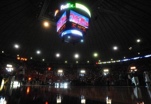 """The overhead scoreboard and emergency lights illuminnate the court after the main lights went out at the main lights at the C.M. """"Tad"""" Smith Coliseum during the first half of an NCAA college basketball game between Arkansas and Mississippi in Oxford, Miss., on Saturday, Jan. 19, 2013. (AP Photo/Oxford Eagle, Bruce Newman)"""