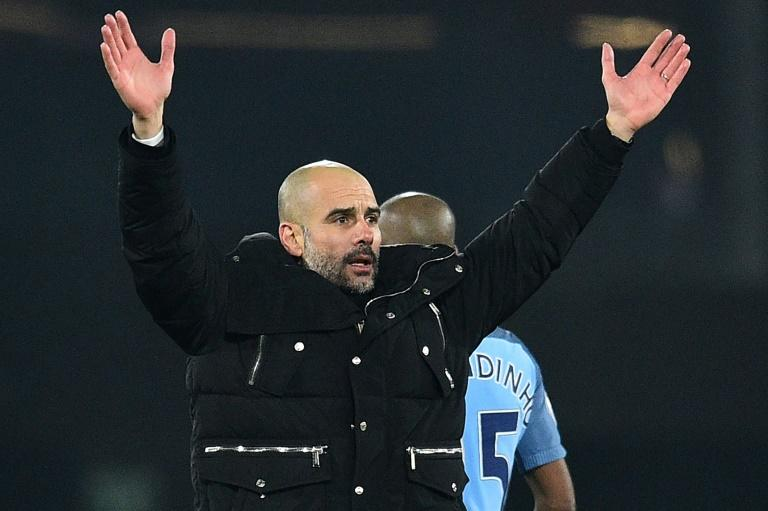 Manchester City's Spanish manager Pep Guardiola celebrates on the pitch after the English Premier League football match between Bournemouth and Manchester City at the Vitality Stadium in Bournemouth, southern England on February 13, 2017