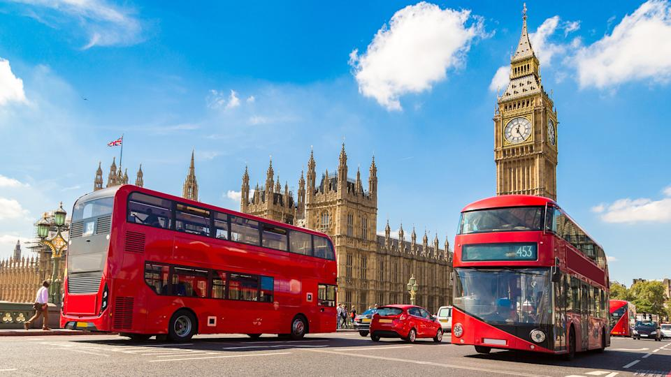 Big Ben, England, How Much to Tip When Traveling to These 25 Countries, United Kingdom, Westminster Bridge and red double decker bus in London