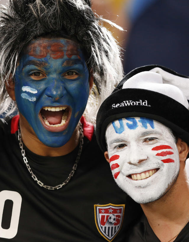 USA fans cheer before the group G World Cup soccer match between Ghana and the United States at the Arena das Dunas in Natal, Brazil, Monday, June 16, 2014. (AP Photo/Julio Cortez)