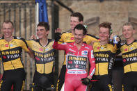 Race winner Primoz Roglic celebrates with Team Jumbo-Visma riders at the end of a time trial on the 21st and last stage of the Vuelta Cycling race in Santiago, Spain, Sunday, Sept. 5, 2021. (AP Photo/Luis Vieira)