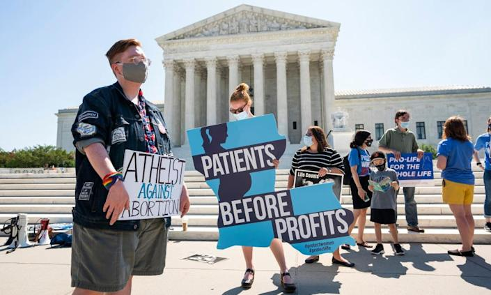 "<span class=""element-image__caption"">Competing protesters, outside the supreme court in June.</span> <span class=""element-image__credit"">Photograph: Jim Lo Scalzo/EPA</span>"