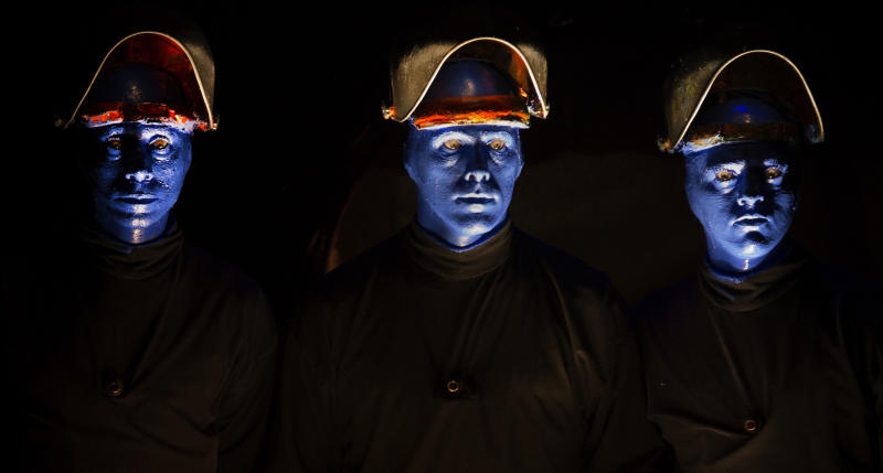 In this July 10, 2013 photograph, members of the Blue Man Group perform at the Briar Street Theatre in Chicago. Blue Man Group, which started with three friends in New York more than two decades ago, has grown from an off-Broadway show to also have productions in Boston, Chicago, Las Vegas and Orlando, Fla. A tour will soon take the blue men to stops in cities like Atlantic City, N.J.; Durham, N.C.; Lincoln, Neb.; Corpus Christi, Texas; Portland, Maine; and Kennewick, Wash. (AP Photo/Scott Eisen)