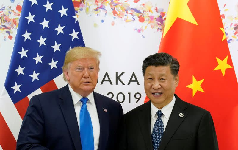 FILE PHOTO: U.S. President Donald Trump and China's President Xi Jinping pose for a photo ahead of their bilateral meeting during the 2019 G20 leaders summit in Osaka, Japan