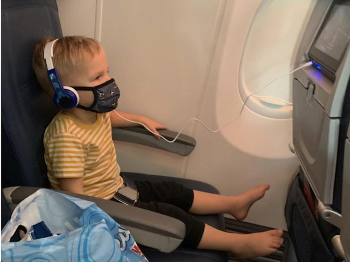 The author's son watching Delta's family friendly in flight entertainment on the plane