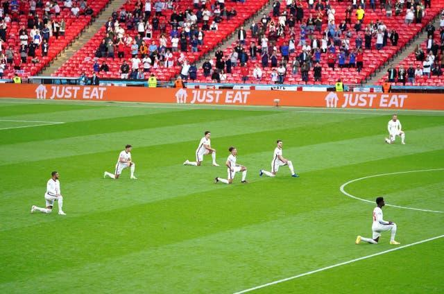England players took a knee ahead of matches at Euro 2020 (Mike Egerton/PA).
