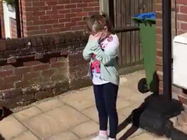Sophie cries as her neighbours sing her Happy Birthday: Twitter/@robthomas_1