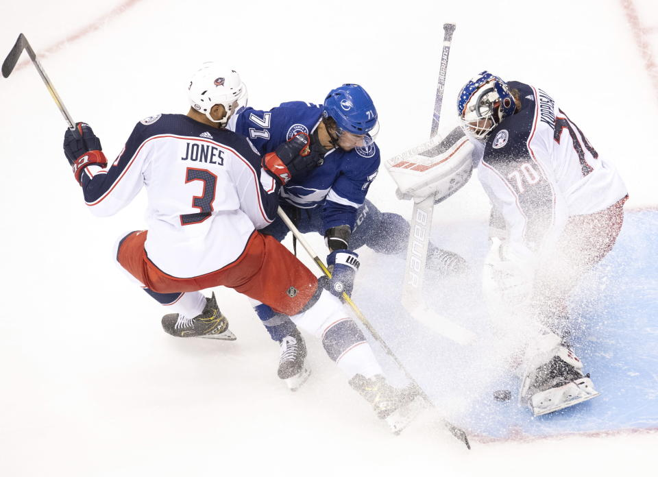 Columbus Blue Jackets defenseman Seth Jones (3) picks up a holding call as Tampa Bay Lightning center Anthony Cirelli (71) makes a short handed breakaway attempt on Jackets goaltender Joonas Korpisalo (70) during the second period in Game 1 of an NHL hockey Stanley Cup first-round playoff series, Tuesday, Aug. 11, 2020, in Toronto. (Frank Gunn/The Canadian Press via AP)