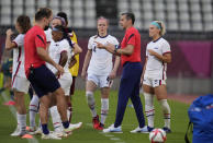 United States' coach Vlatko Andonovski, 2nd right, talks with his players before the second half of a women's soccer match against Australia at the 2020 Summer Olympics, Tuesday, July 27, 2021, in Kashima, Japan. (AP Photo/Fernando Vergara)