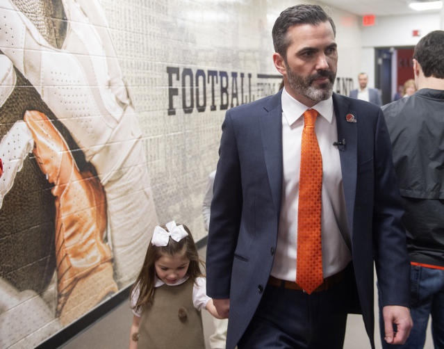 Cleveland Browns new NFL football head coach Kevin Stefanski enters a news conference with his daughter Juliet at FirstEnergy Stadium in Cleveland, Tuesday, Jan. 14, 2020. (AP Photo/Phil Long)