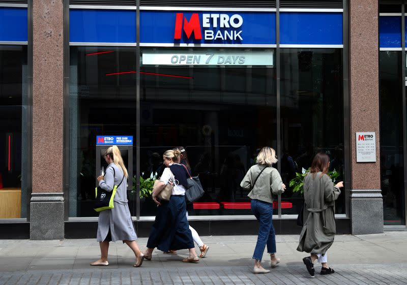 FILE PHOTO: People walk past a Metro Bank in London