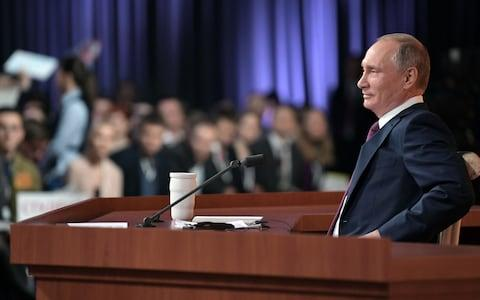 Russian President Vladimir Putin speaks during his annual press conference in Moscow - Credit: AFP