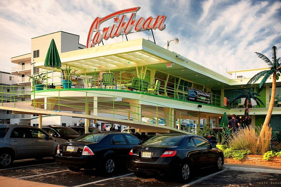 "<p>Wildwood Crest in Cape May County, New Jersey is home to this quirky motel. The 50s, doo-wop style incorporated a crescent-shaped pool, canted glass walls, and near-neon colors which remain today, as well as wonderfully tacky palm trees decorations throughout.<br></p><p><strong>EXPLORE NOW:</strong> <a href=""https://www.tripadvisor.com/Hotel_Review-g46932-d121340-Reviews-Caribbean_Motel-Wildwood_Crest_Cape_May_County_New_Jersey.html"" rel=""nofollow noopener"" target=""_blank"" data-ylk=""slk:Caribbean Motel"" class=""link rapid-noclick-resp"">Caribbean Motel</a></p>"