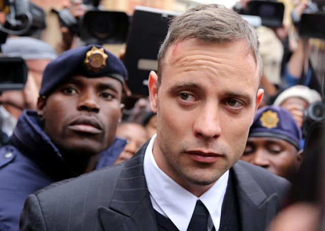 Former Paralympian Oscar Pistorius is escorted by police officers as leaves after the second day of his sentencing for the murder of his girlfriend Reeva Steenkamp, at Pretoria High Court, South Africa June 14, 2016. REUTERS/Siphiwe Sibeko