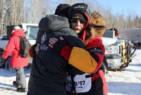 FILE PHOTO: Two-times champion Mitch Seavey hugs son, Dallas Seavey (four-times champion) before they both race at the official restart of the Iditarod, a nearly 1,000 mile (1,610 km) sled dog race across the Alaskan wilderness, in Fairbanks, Alaska, U.S. March 6, 2017.  REUTERS/Nathaniel Wilder/File Photo