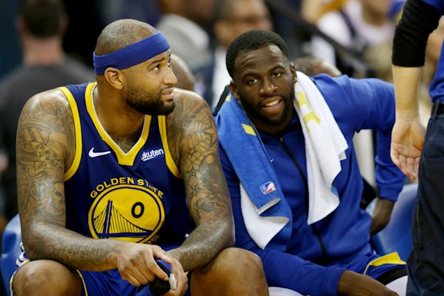 """DeMarcus Cousins (0) and Draymond Green (23) talk each other. (Ray Chavez/MediaNews Group/The Mercury News via Getty Images)""""n"""