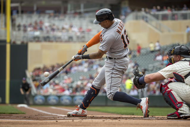 FILE - In this May 23, 2018, file photo, Detroit Tiger' Leonys Martin hits against the Minnesota Twins in the first inning of a baseball game in Minneapolis. Badly needing outfield help, the Cleveland Indians have acquired center fielder Leonys Martin from the Detroit Tigers. Cleveland also received right-hander Kyle Dowdy in the deal Tuesday in exchange for shortstop prospect Willi Castro. (AP Photo/Bruce Kluckhohn, File)