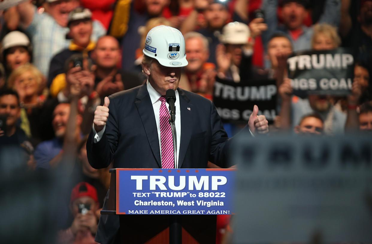 Then presidential candidate Donald Trump models a hardhat in support of miners at a rally in Charleston, W.Va., May 5, 2016. (Photo: Mark Lyons/Getty Images)