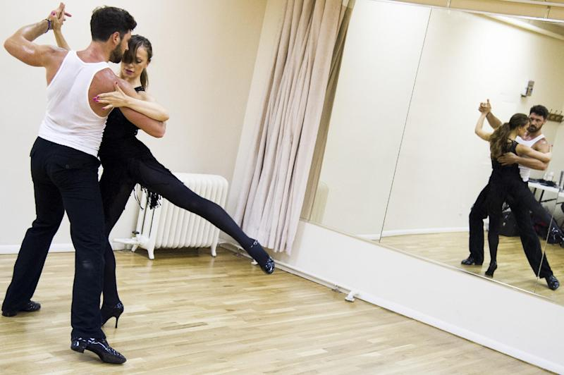 "In this June 28, 2013 photo, dancers Karina Smirnoff and Maksim Chmerkovskiy rehearse for the upcoming Broadway show ""Forever Tango"" in New York. Smirnoff and Chmerkovskiy, best known for their work on ""Dancing with the Stars,"" will star in the revival of Luis Bravo's ""Forever Tango,"" which traces the dance's birth on the streets of 19th-century Buenos Aires to its more modern manifestations. (Photo by Charles Sykes/Invision/AP)"