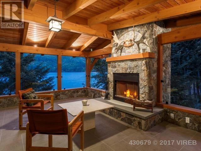 <p><span>3905 #407-3676 Horne Lake Caves Rd., Qualicum Beach, B.C.</span><br> The natural tones used throughout the home will make you feel as if you're living right in the outdoors. And on the screened-in deck with fireplace, you basically will be!<br> (Photo: Zoocasa) </p>