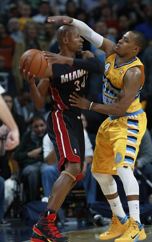 Miami Heat guard Ray Allen, left, looks to shoot the ball as Denver Nuggets guard Randy Foye covers in the fourth quarter of the Heat's 97-94 victory in an NBA basketball game in Denver on Monday, Dec. 30, 2013. (AP Photo/David Zalubowski)