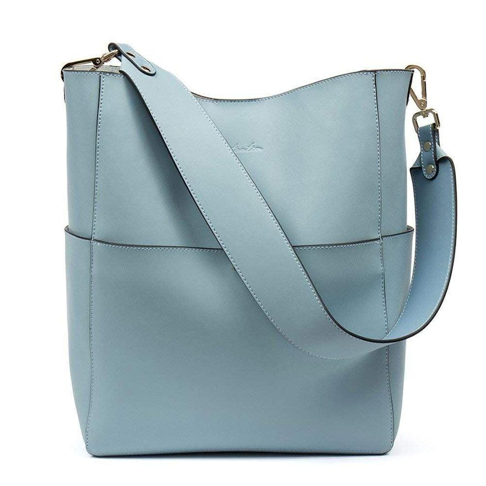 """<p>We're in love with everything about this <a href=""""https://www.popsugar.com/buy/Bostanten-Bag-585810?p_name=Bostanten%20Bag&retailer=amazon.com&pid=585810&price=70&evar1=fab%3Aus&evar9=46804763&evar98=https%3A%2F%2Fwww.popsugar.com%2Ffashion%2Fphoto-gallery%2F46804763%2Fimage%2F46804771%2FThis-Essential-Bag&list1=shopping%2Cfall%20fashion%2Camazon%2Cfall&prop13=mobile&pdata=1"""" class=""""link rapid-noclick-resp"""" rel=""""nofollow noopener"""" target=""""_blank"""" data-ylk=""""slk:Bostanten Bag"""">Bostanten Bag</a> ($70). It can be carried from the top handle or worn crossbody.</p>"""