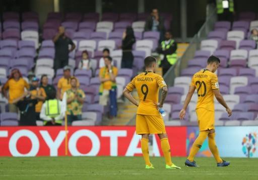 Down after going under: Australia's defence of their Asian title grew tougher after an opening loss to Jordan