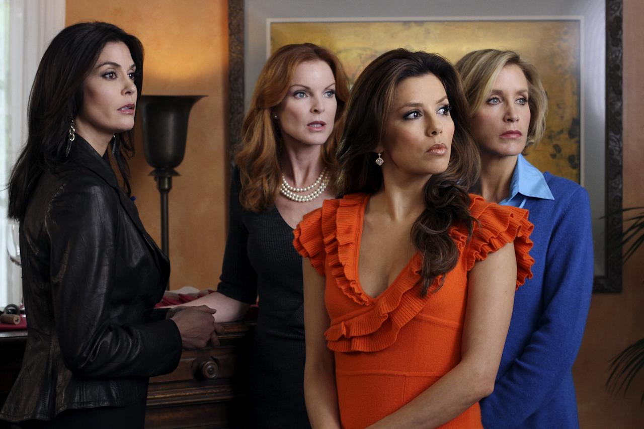 "DESPERATE HOUSEWIVES - ""Lovely"" - Susan causes quite a stir when she invites a former stripper into her home on ABC's ""Desperate Housewives,"" SUNDAY, FEBRUARY 21 (9:00-10:01 p.m., ET). Former exotic dancer Robin will have a profound effect on Susan's friends -- with three teenage boys at home, Lynette will keep a watchful eye; Bree picks up a few tricks to engage Orson; Gaby looks for help with troublesome niece Ana; and Katherine will find a friendly companion. (Photo by Eric McCandless/ABC via Getty Images) TERI HATCHER, MARCIA CROSS, EVA LONGORIA PARKER, FELICITY HUFFMAN"