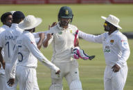 South Africa's Faf du Plessis is caught out on 199 and is congratulated by the Sri Lankan team players, on day three of the first cricket test match between South Africa and Sri Lanka at Super Sport Park Stadium in Pretoria, South Africa, Monday, Dec. 28, 2020. (AP Photo/Catherine Kotze)