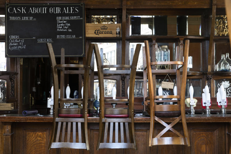 LONDON, ENGLAND - MAY 18: Stools are placed on a bar in a closed pub in Clapham Junction on May 18, 2020 in London, England. The British government has started easing the lockdown it imposed two months ago to curb the spread of Covid-19, abandoning its 'stay at home' slogan in favour of a message to 'be alert', but UK countries have varied in their approaches to relaxing quarantine measures. (Photo by Dan Kitwood/Getty Images)